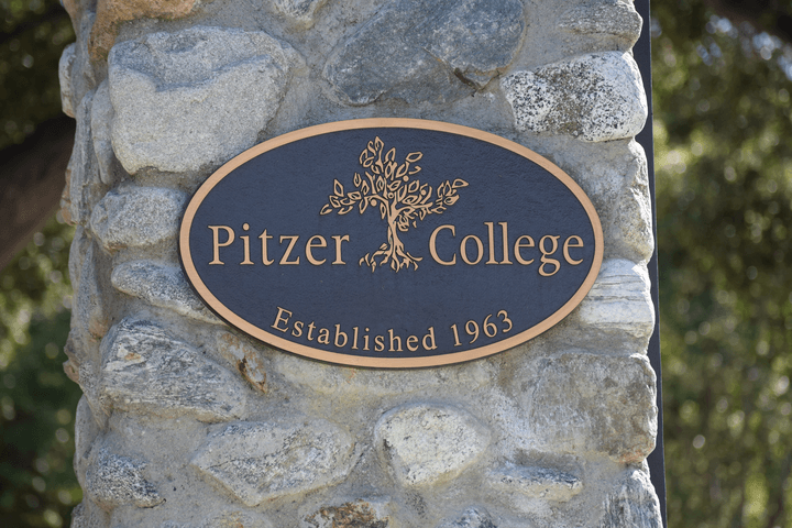 Pitzer College plaque on gate