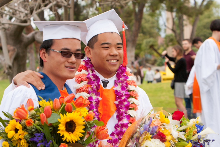commencement 2015, two asian men with flowers