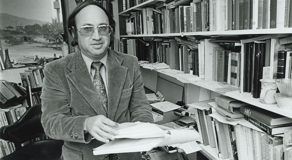 Founding faculty member Steve Glass, professor of classics, in his office in the 1970s.