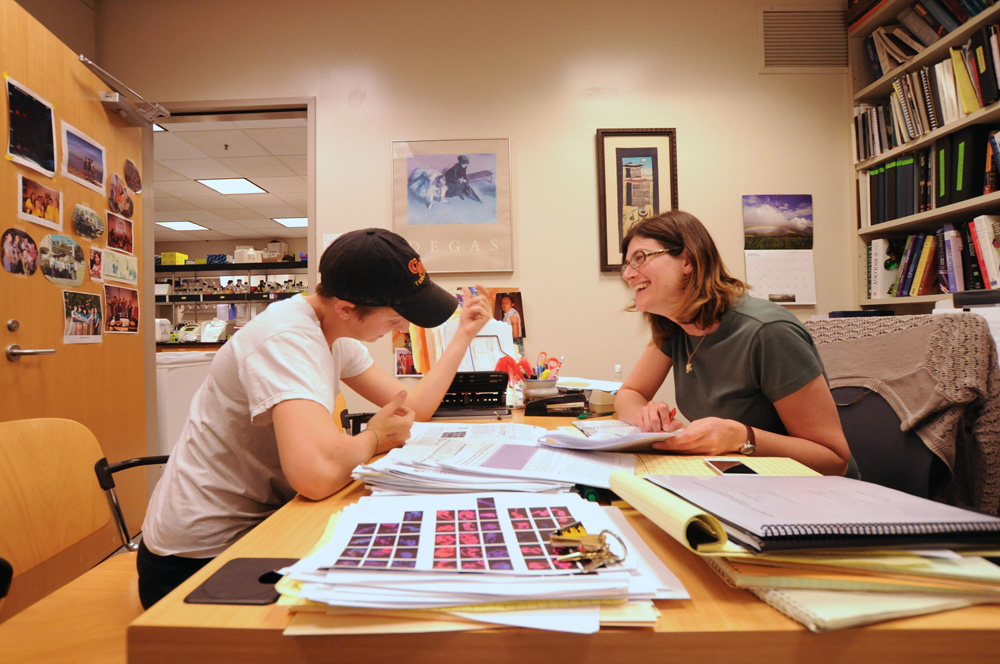 A professor talks to a student in her office at Keck Science Center.
