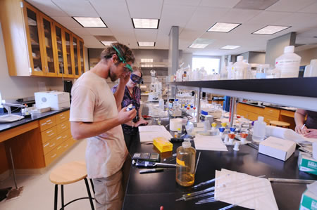 Philip Paulson '12 and Associate Professor of Chemistry Kathleen Purvis-Roberts prepare a gas chromatography experiment in the W.M. Keck Science Department.