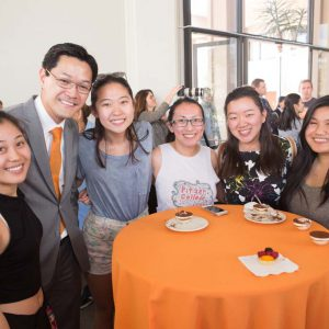 Interim President Thomas Poon and students.