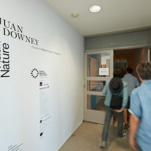 People enter the Nichols Gallery at Pitzer College.