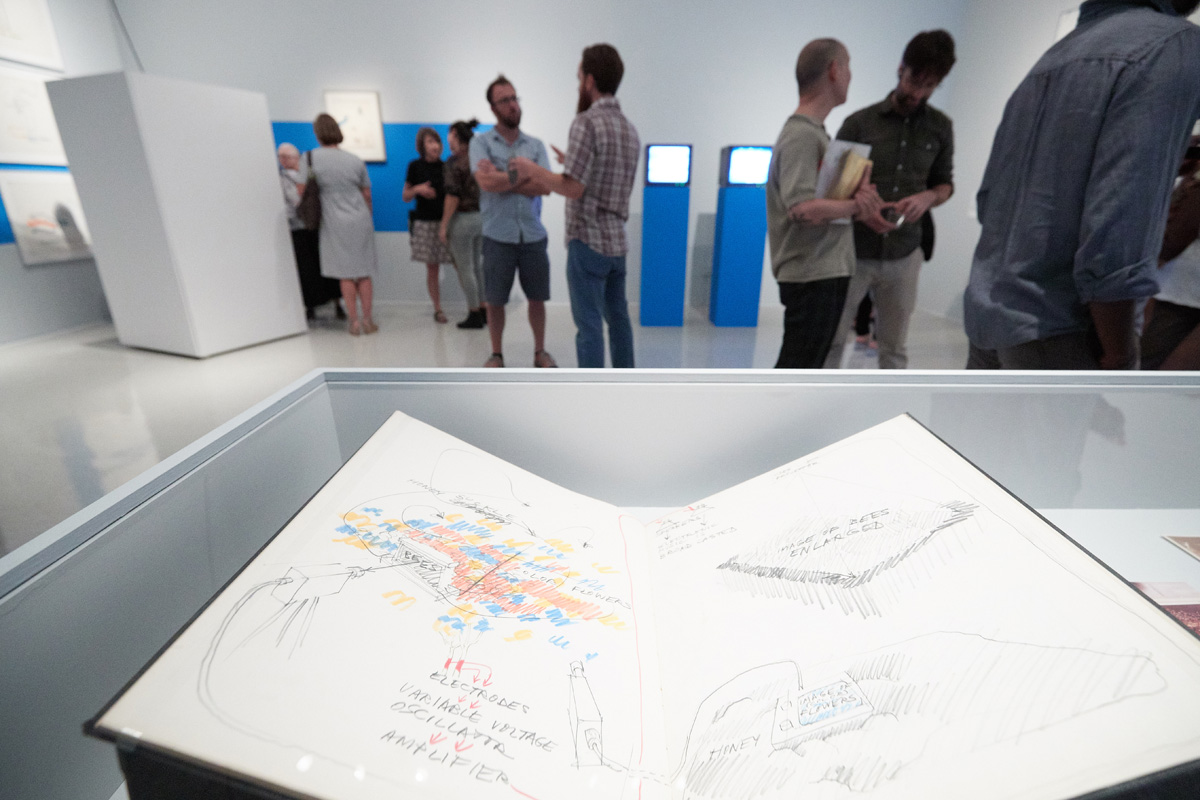 Photograph of artist Juan Downey's journals and drawings.