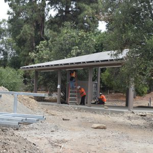 Construction of one of the outdoor classrooms with solar panels on the roof.