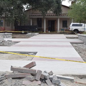 Construction of the front entrance and patio underway.