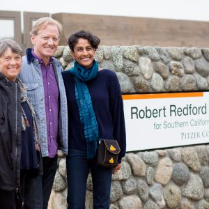 Trustee and donor Susan Pritzker, director and filmmaker James Redford and Conservancy Director Professor Brinda Sarathy by the Redford Conservancy sign on Foothill Boulevard in March 2018.