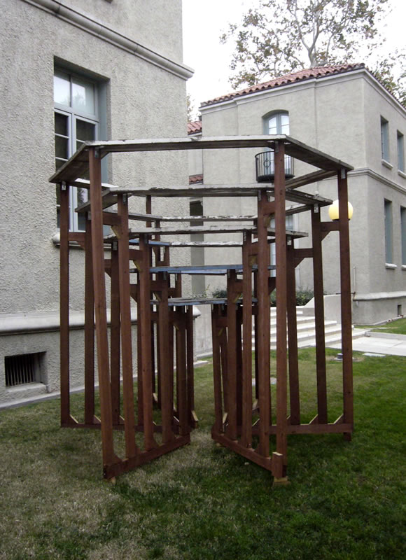 In (2011); Pressure Treated Wood and Aluminum; 10 x 10 x 10 inches