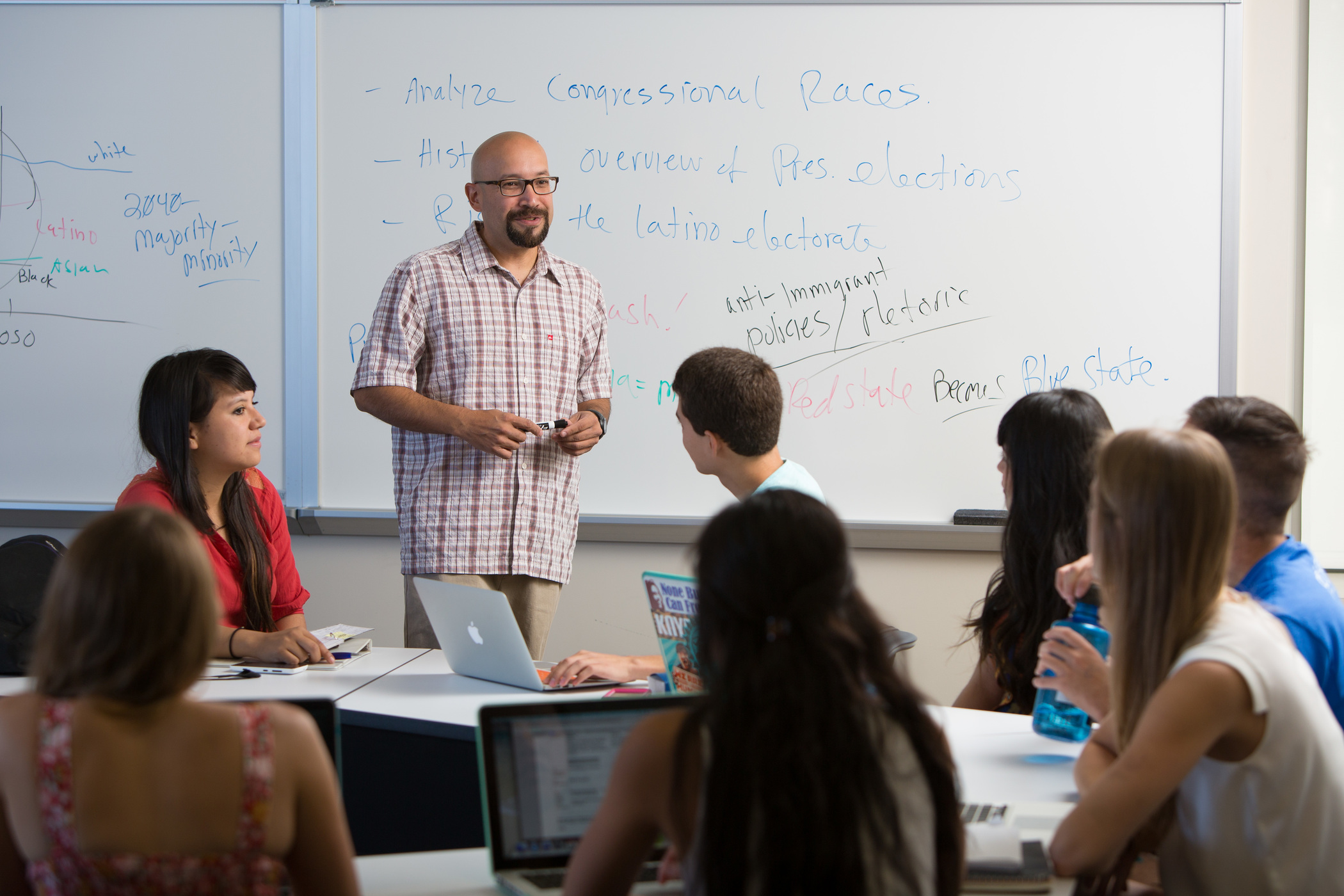 college classroom whiteboard. adrian pantoja, professor of political studies and chicano studies, teaching in the classroom with college whiteboard r