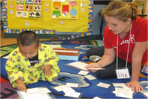 A PItzer student reads with a young child.