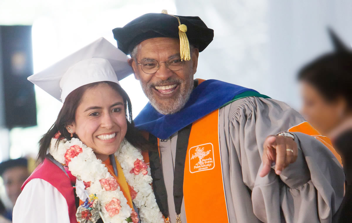 President Melvin L. Oliver celebrates with a graduate from the Class of 2017.