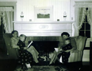 Fireplace in 1942 with parents reading to children.