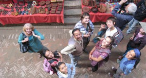 Pitzer group in Nepal market look up at the camera.