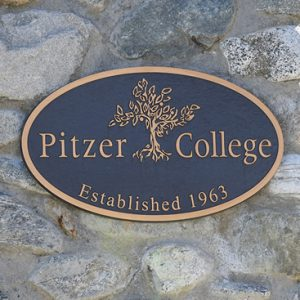Pitzer College plaque on stone pillar